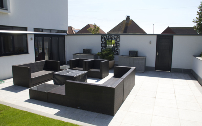Contemporary Garden Design With Granite Two Tone Paving And Bespoke Mirror Water Features And Fire