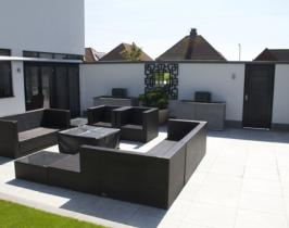 Contemporary garden design with granite two tone paving and bespoke mirror, water features and fire pit
