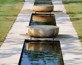 Traditional garden design with a water rill