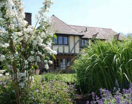 Traditional garden design for a timber framed house