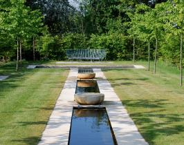 Garden water feature designed with a long rill dressed with French Limestone