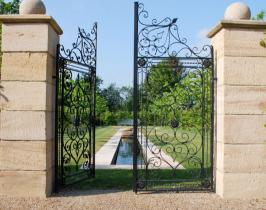 Traditional garden design with bespoke gates and water rill