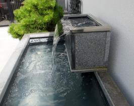 Garden water feature with granite stone cladding