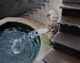 Marble River God water spout delivering water into deep pool in an epic Italianate garden feature